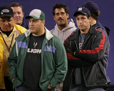 Adam Sandler and Kevin James stand on the sidelines