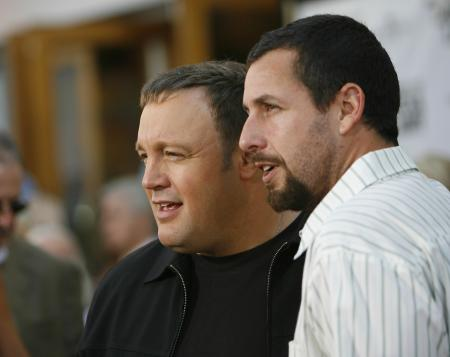 Adam Sandler with a squinting Kevin James at Universal Studios