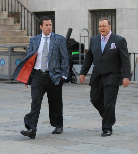 Adam Sandler and Kevin James walking in suits