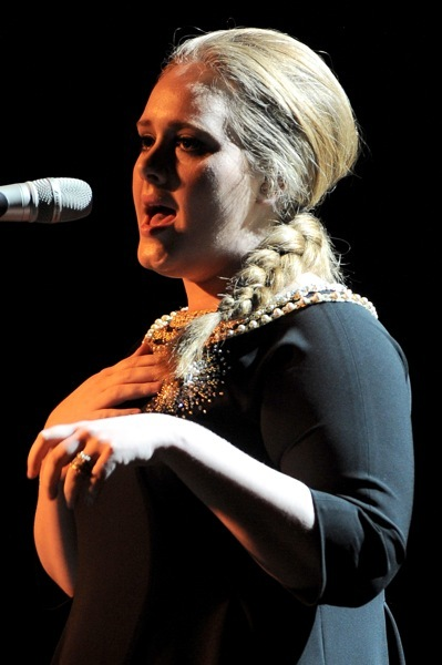 Adele with a single braid