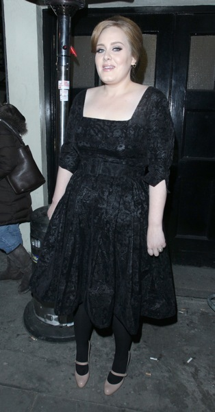 Adele in a belt