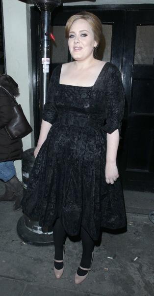Adele in a belt