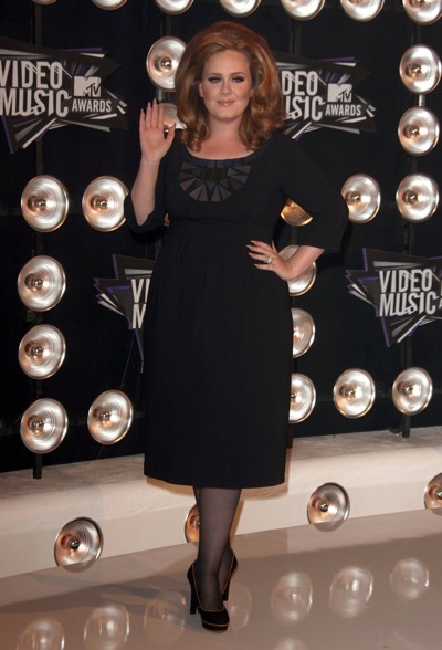 Adele in a black dress