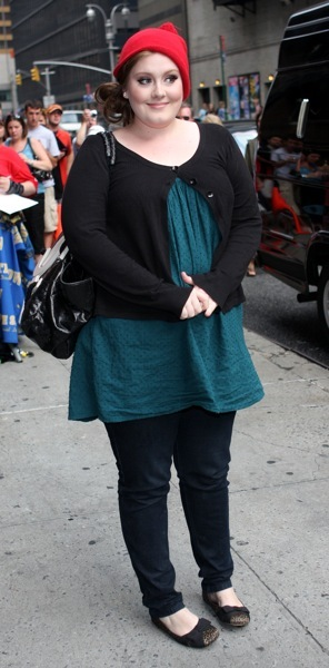 Adele in a cardigan