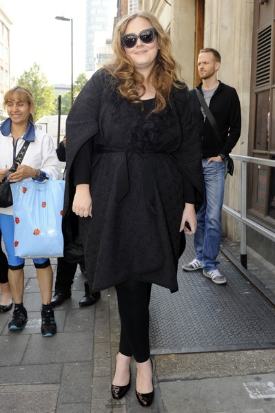 Adele with floral overcoat