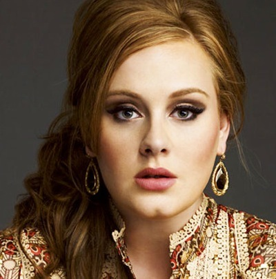 Adele in a blouse