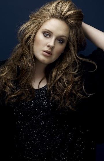 Adele in cascading curls