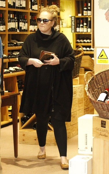 Adele in gold flats