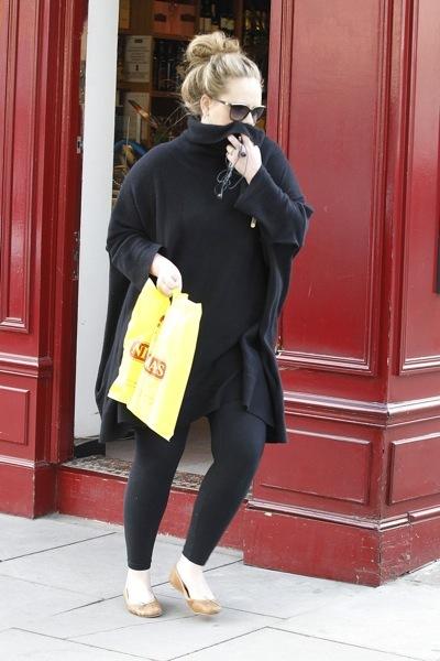 Adele with a high bun