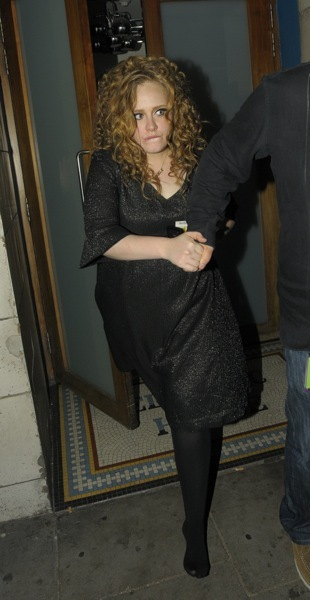 Adele with tight curls