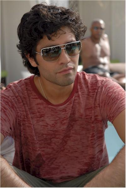 Adrian Grenier looks very relaxed in this poolside shot