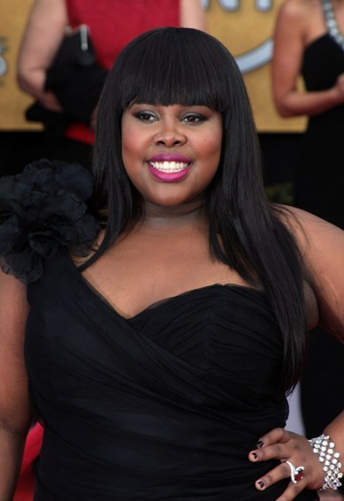 Amber Riley's sleek hairstyle with blunt bangs