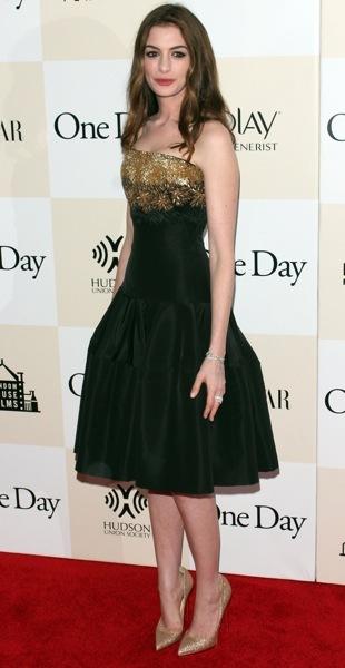 Anne Hathaway in a green dress