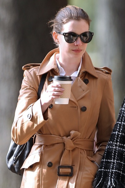 Anne Hathaway in a trench coat