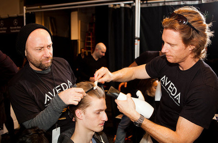 Male model gets his hair styled