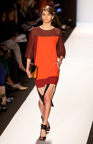 Sheer-shouldered orange and maroon dress