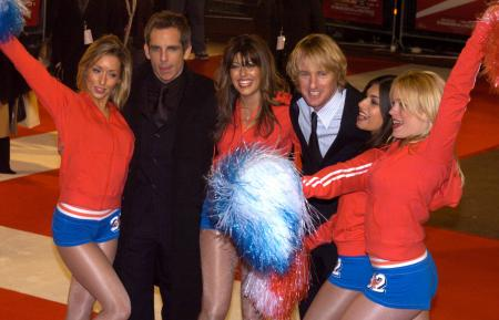 Ben Stiller and Owen Wilson pose with cheerleaders at their premiere