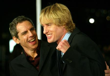 Owen Wilson makes a fist next to Ben Stiller while at their movie premiere