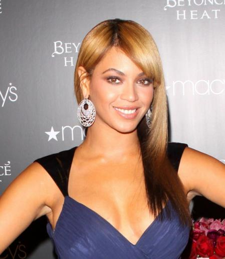 Beyonce wearing a straight long hairstyle with bangs while launching her new