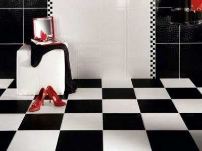Black and white bathroom with red accents