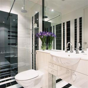 Black and white tile bathroom with purple accent - Black and white