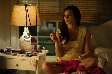 Emma Watson with a gun in The Bling Ring