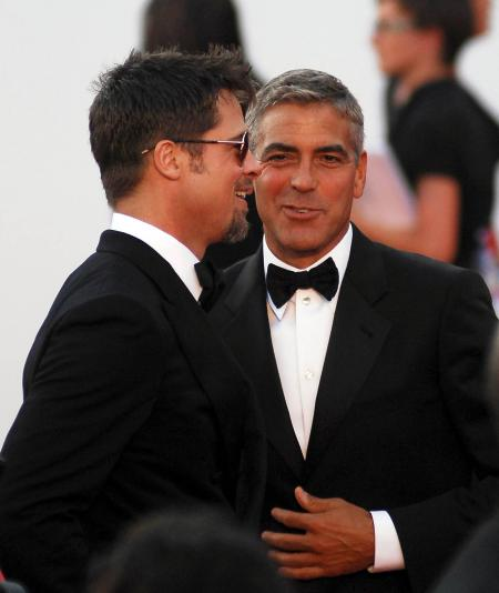 Brad Pitt and George Clooney share a laugh at a film festival
