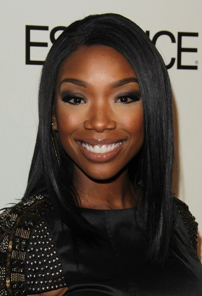 Brandy's sleek, straight hairstyle