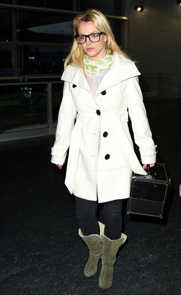 Britney Spears in white trench coat