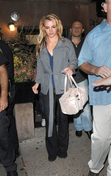 Britney Spears with beige purse