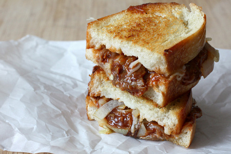 Caramelized onion and barbecued pulled pork grilled cheese