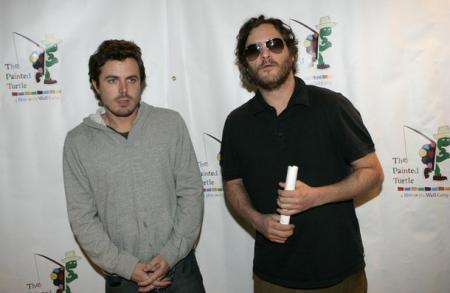 Casey Affleck stands next to Joaquin Phoenix at Davis Symphony Hall
