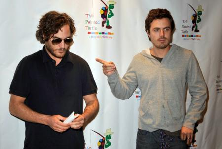 Casey Affleck is photographed pointing to Joaquin Phoenix at the Davis Symphony Hall
