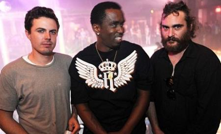 Puff Daddy looks at Joaquin Phoenix at a pre-New Year's Eve party