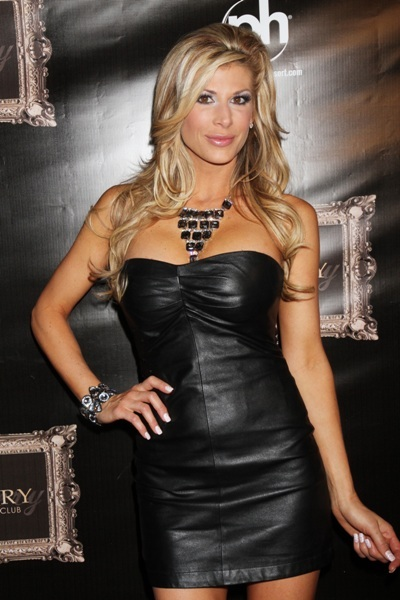 Real Housewife star Alexis Bellino bares all in a mini leather dress.