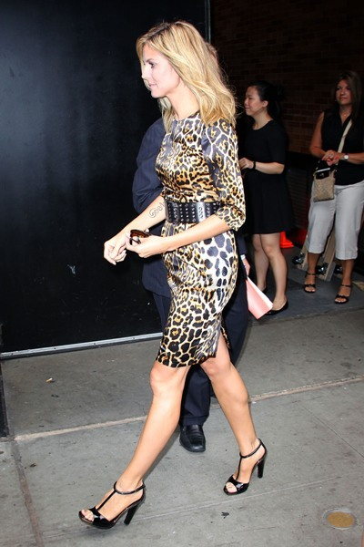 Heidi Klum shows her edgy side in an animal print dress and studded belt.
