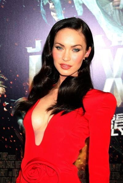 Megan Fox is fiercly sexy in a plunge neck dress.