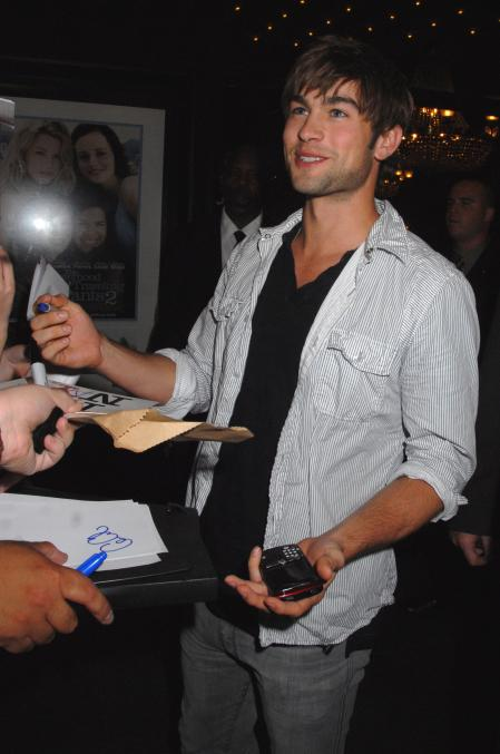 Chase Crawford signs autographs for adoring fans