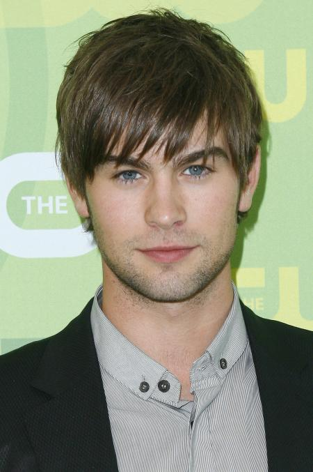 Chase Crawford poses for a picture at a Gossip Girls event