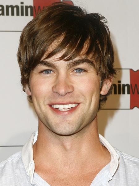 Chase Crawford smiles for the camera at a Vitamin Water event