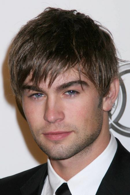 Chase Crawford is pictured with shaggy hair