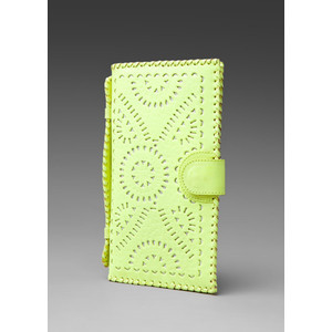 Stash your essentials for a night on the town in this adorable neon yellow clutch available from Revolve Clothing.