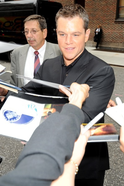Matt Damon signs for fans