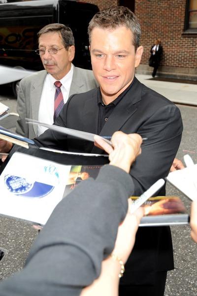 Matt Damon signs for fans