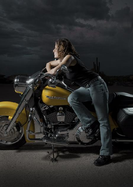 Darnell posing on her Harley-Davidson Motorcycle