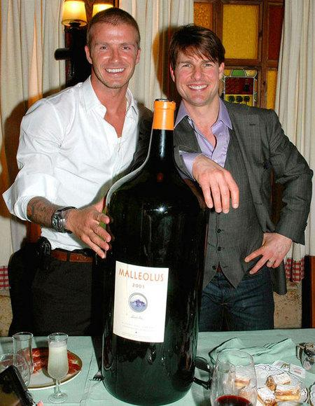 David Beckham and Tom Cruise pose with an oversized wine bottle