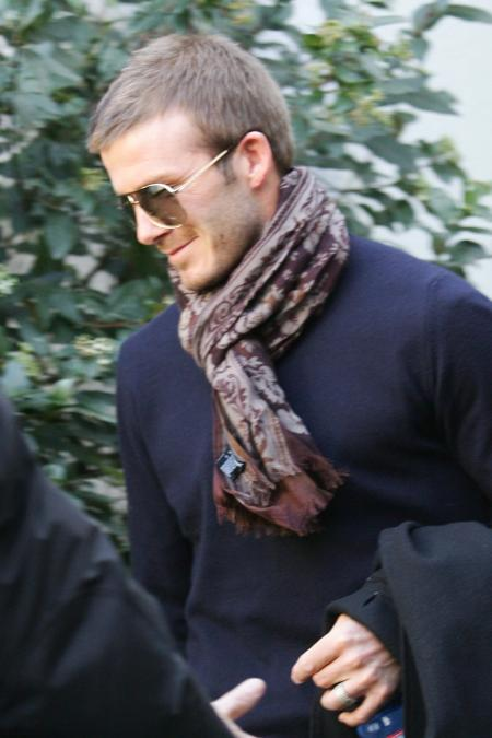 David Beckham stays warm in a scarf
