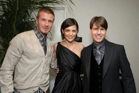 Katie Holmes sandwiched between husband Tom Cruise and David Beckham