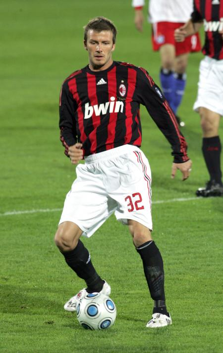 David Beckham playing soccer for AC Milan.