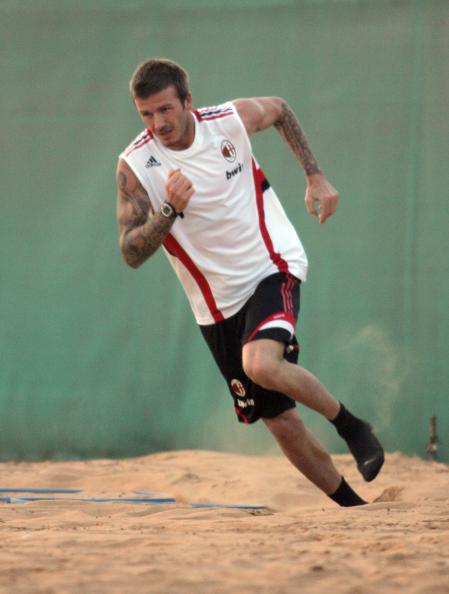 David Beckham runs in the sand